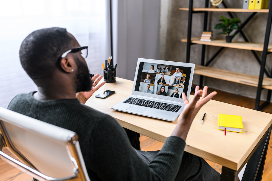 Man on laptop meeting virtually